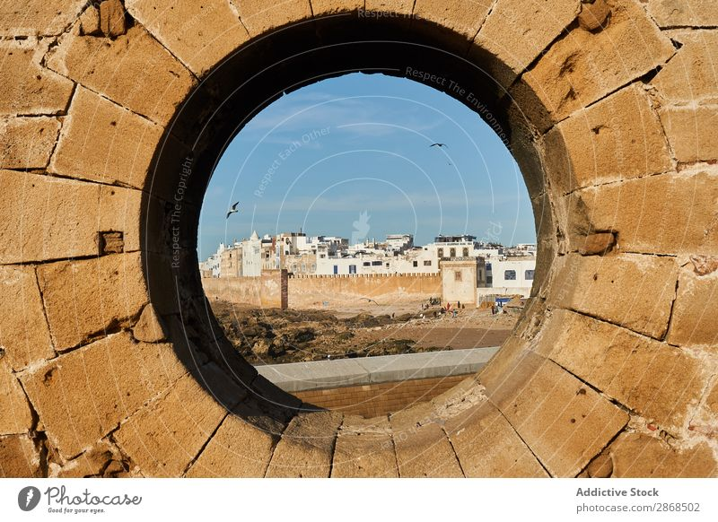 Stone monument with round hole Monument Town Ancient Essaouira Morocco Round Hole Abstract Rock Circle Sky Blue Picturesque Vantage point Old Architecture
