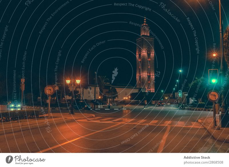 Road on street near high tower at night Tower Old Street carrefour Marrakesh Morocco Night Evening Height Town Lanes & trails Asphalt Wide Black Architecture