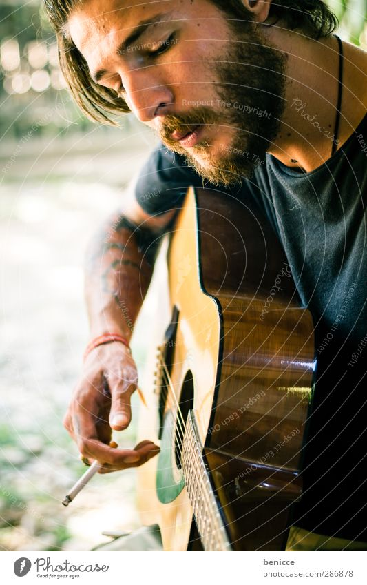 strings and smoke Man Human being Guitar Playing Smoking Tobacco products Cigarette Facial hair Beard Musician Composer Rocker Tattoo Tattooed Nature Make music