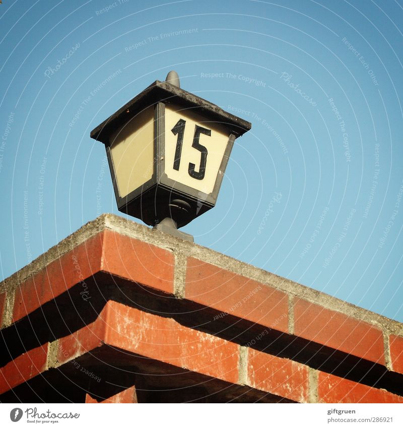 15 House (Residential Structure) Blue Digits and numbers Characters Symbols and metaphors House number Wall (barrier) Brick Brick red Brick construction Lantern