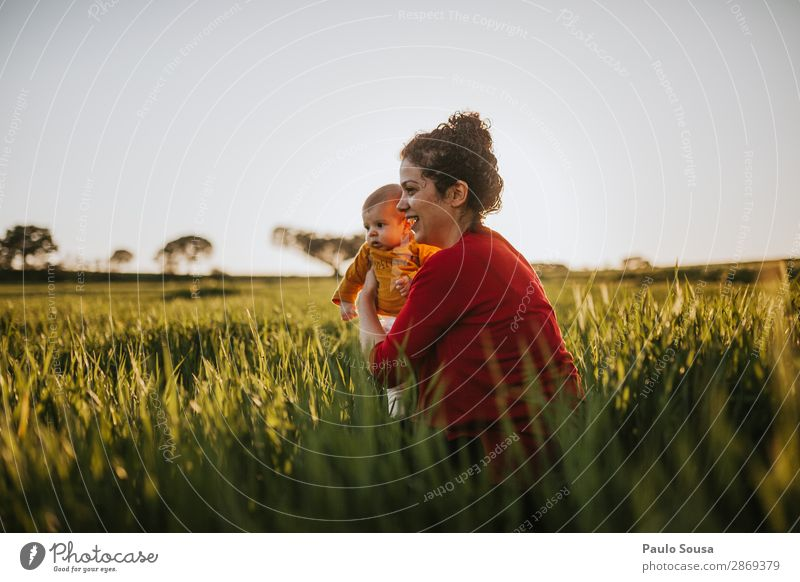 Mother and Baby in Nature Child Human being Youth (Young adults) Young woman Beautiful Green Red 18 - 30 years Lifestyle Adults Environment Love Natural