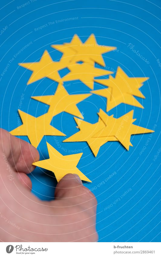 sort yellow stars Economy Advertising Industry Gastronomy Business Career Success Fingers Stars Paper Decoration Sign Select Movement To hold on Blue Yellow