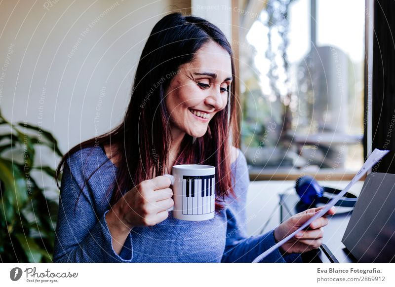 young woman holding a cup of coffee at home Coffee Style Beautiful Leisure and hobbies Playing Music Human being Feminine Young woman Youth (Young adults) Woman