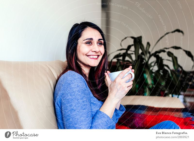 young caucasian woman having coffee at home Breakfast Beverage Coffee Tea Lifestyle Happy Leisure and hobbies Sofa Human being Feminine Young woman