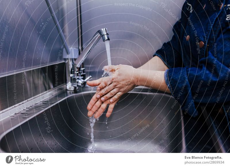 woman washing hands in bakery business. indoor Personal hygiene Bathroom Business Feminine Woman Adults Hand Fingers 1 Human being 45 - 60 years Wet Clean