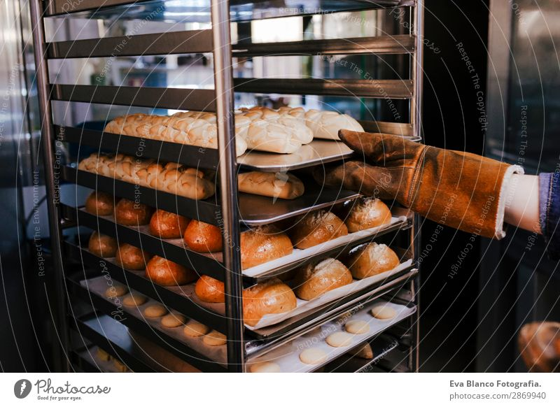 woman holding rack of rolls in a bakery Bread Happy Kitchen Restaurant School Work and employment Profession Camera Feminine Woman Adults Hand 1 Human being