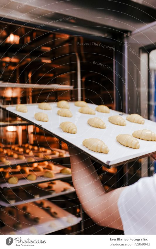 woman holding rack of croissants in a bakery Bread Happy Kitchen Restaurant School Work and employment Profession Camera Feminine Woman Adults Hand 1