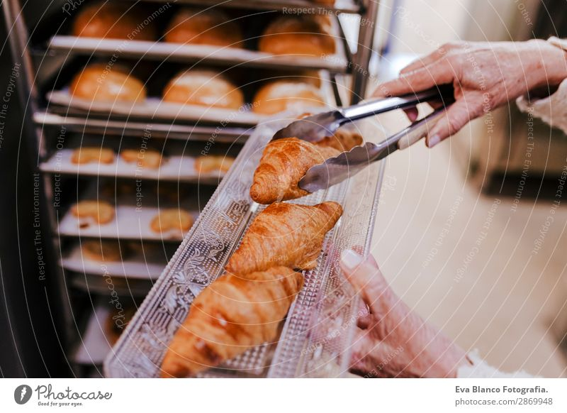 woman holding holding rack of croissants Bread Happy Kitchen Restaurant School Work and employment Profession Camera Feminine Woman Adults 1 Human being