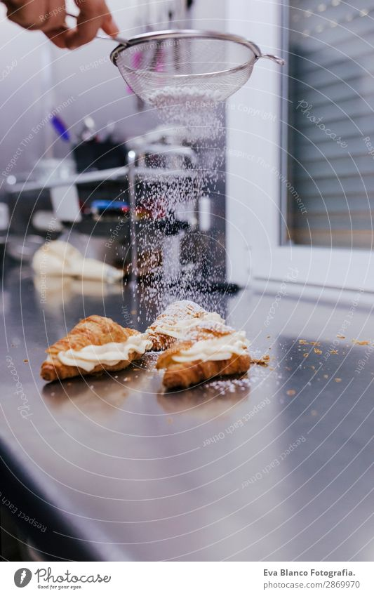 woman hands sprinkling white flour over croissants Dough Baked goods Bread Roll Croissant Nutrition Kitchen Human being Feminine Woman Adults Arm Hand 1