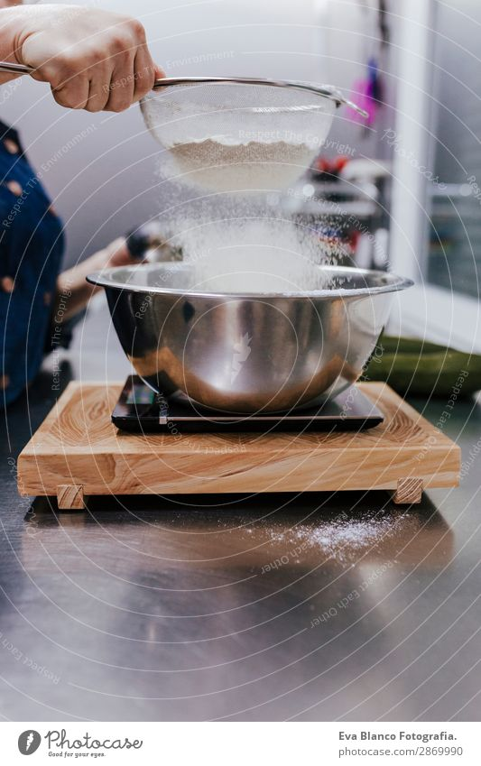 female hands sifting flour by sieve in bowl for recipe Bowl Human being Feminine Woman Adults Hand 1 45 - 60 years Sieve Steel Movement Make White Tabletop chef