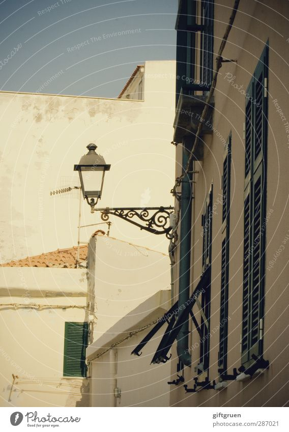 Lantern II House (Residential Structure) Facade Window Bright Street lighting Lighting Shutter Curlicue White Sky Southern Europe Old Old town Italy Closed