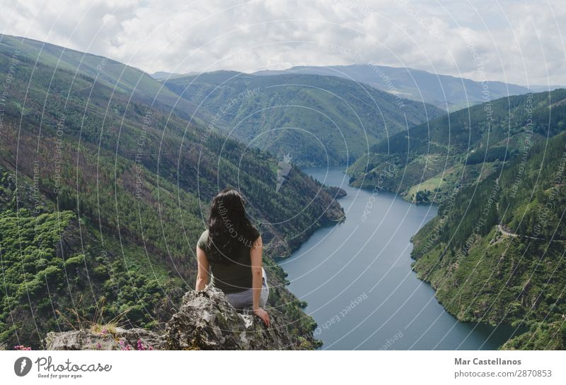 Woman from behind looking at the river. Human being Vacation & Travel Nature Summer Plant Beautiful Green Landscape Tree Flower Clouds Calm Forest Mountain