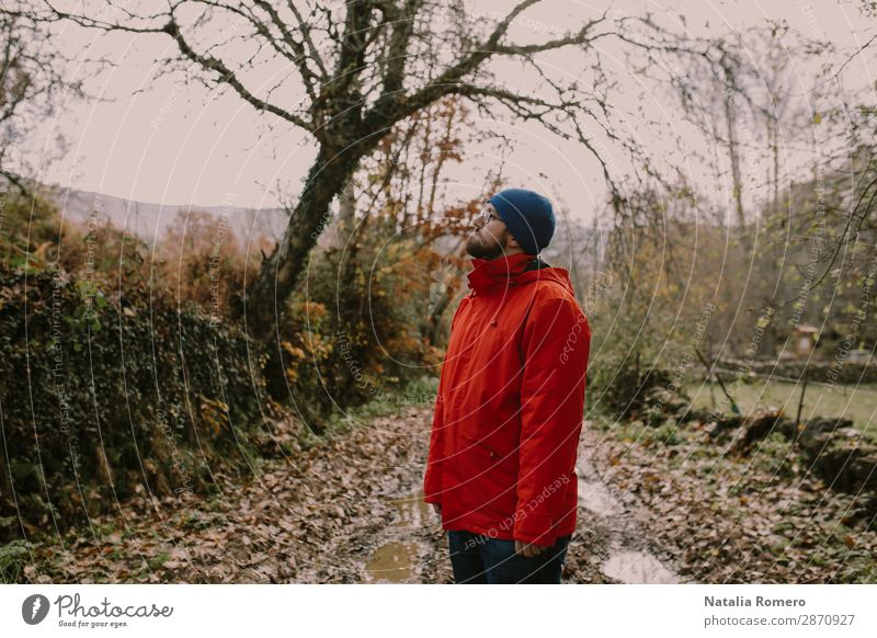 Boy in a red coat is on a mud road Lifestyle Happy Relaxation Leisure and hobbies Vacation & Travel Adventure Hiking Sports Retirement Man Adults Landscape