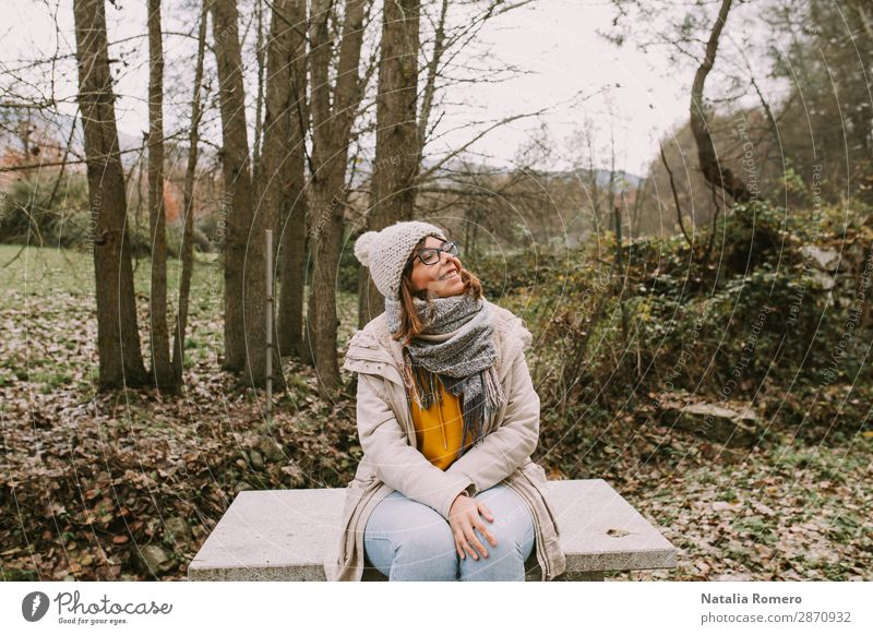 Young woman is sitting in the middle of the forest Lifestyle Happy Beautiful Vacation & Travel Adventure Mountain Hiking Garden Human being Woman Adults Nature