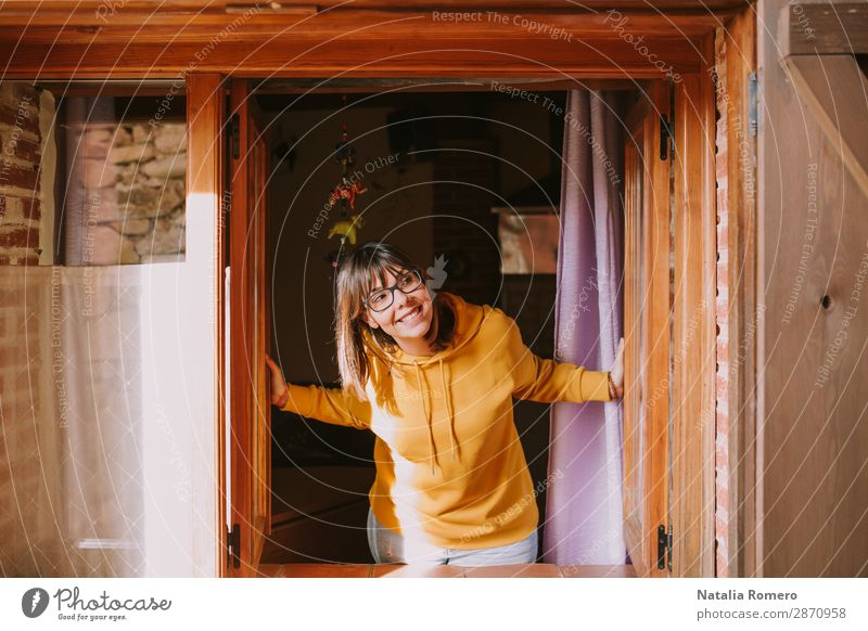 a young woman in a yellow sweatshirt opens the window Woman Human being Vacation & Travel Nature Youth (Young adults) Beautiful House (Residential Structure)