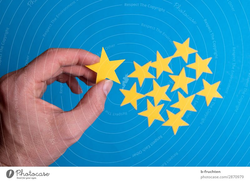 Select stars Economy Business Career Success Man Adults Hand Fingers Stars Paper Sign Utilize To hold on Communicate Together Blue Yellow Agreed Loyal