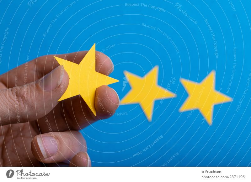 My rating Economy Advertising Industry Business Career Success Hand Fingers Paper Sign Select Movement To hold on Communicate Blue Yellow Star (Symbol) Decision