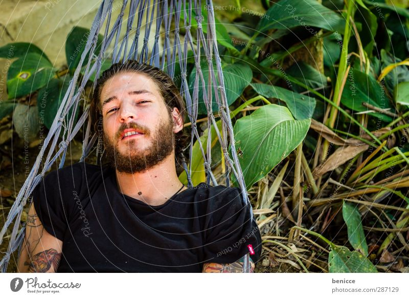 hang out Man Human being 20-30 years Lie Hammock Laughter Smiling Looking into the camera Facial hair Beard European Caucasian Bird's-eye view Nature