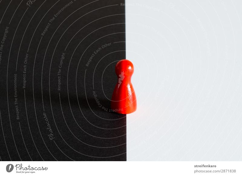 Red toy figure stands on the border between black and white background Toys Piece Wood Dark Infinity Curiosity Rebellious Black White Brave Flexible Interest
