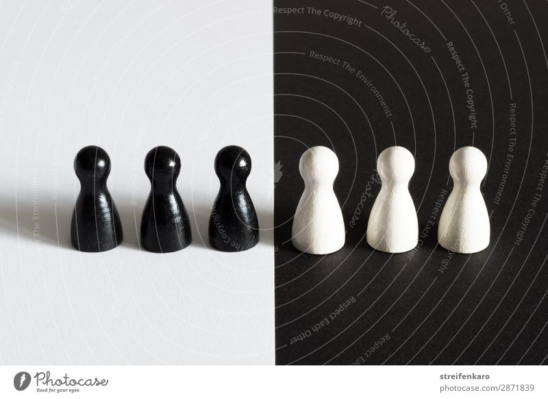 Black game pieces on white background face white game pieces on black background Group Toys Piece Wood Observe White Acceptance Together Solidarity Tolerant