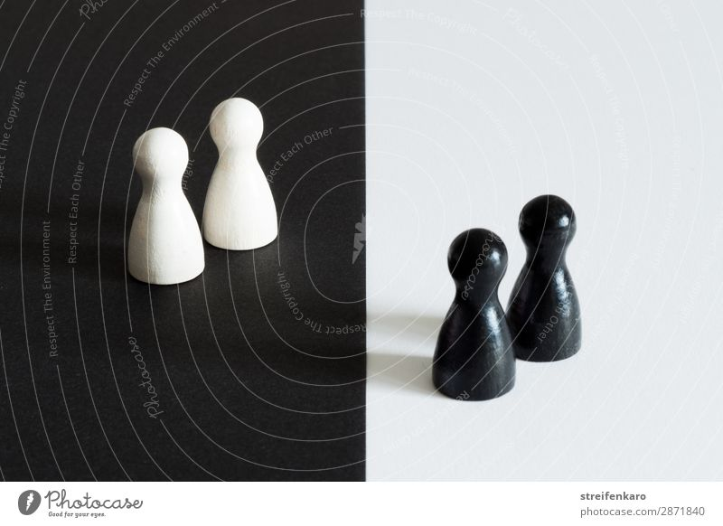 Two white game pieces on a black background are facing two black game pieces on a white background Piece Group Toys Wood Sign Observe Stand Curiosity Black