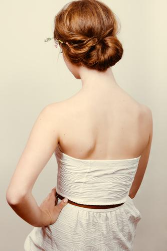 Rear view of a young redhead woman in a white dress with a bun Roll Skin Wedding Human being Feminine Woman Adults Flower Rose Fashion Dress Blonde Red-haired