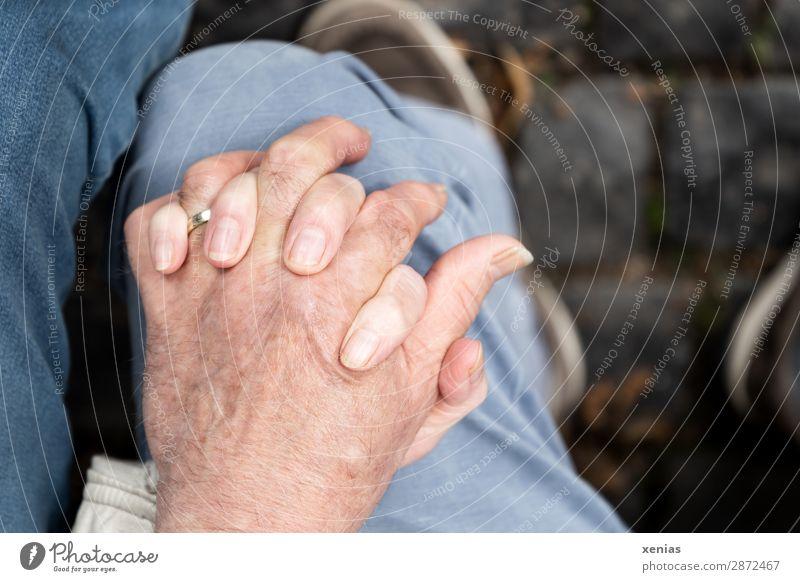 Two hands on one knee Masculine Feminine Woman Adults Man Female senior Male senior Family & Relations Couple Partner Senior citizen by hand Fingers Legs Knee 2