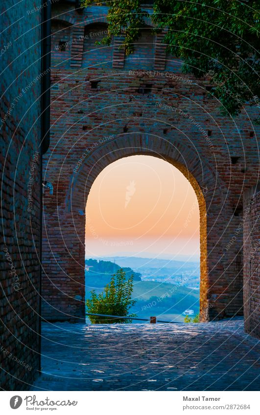 Sunset Through an Arch Tourism Landscape Castle Building Monument Stone Old Historic Europe Gradara Italy Marche Ancient brick entrance Way out fort fortress