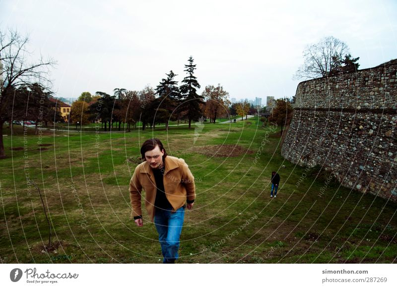 Human being Vacation & Travel Youth (Young adults) City Far-off places Wall (building) Building Wall (barrier) Park Tourism Hiking Trip Europe Adventure