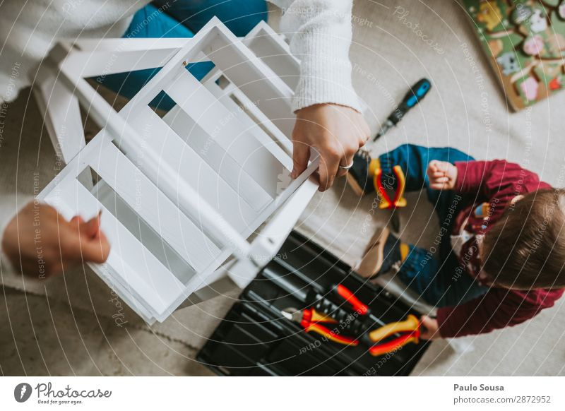 Woman assembling furniture at home with Daughter Child Human being Youth (Young adults) Young woman Town 18 - 30 years Lifestyle Adults Interior design Love