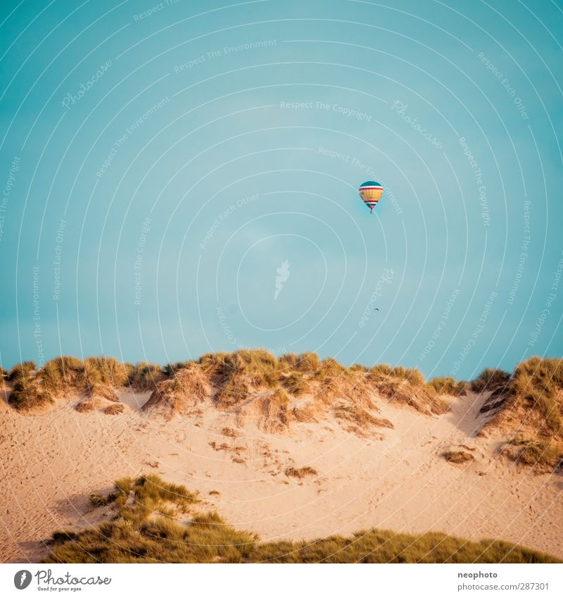 Around the world in 80 days Sand Sky Coast Blue Yellow Gold Beach Dune Hot Air Balloon Aviation Hover Square Wind Travel photography Colour photo Exterior shot