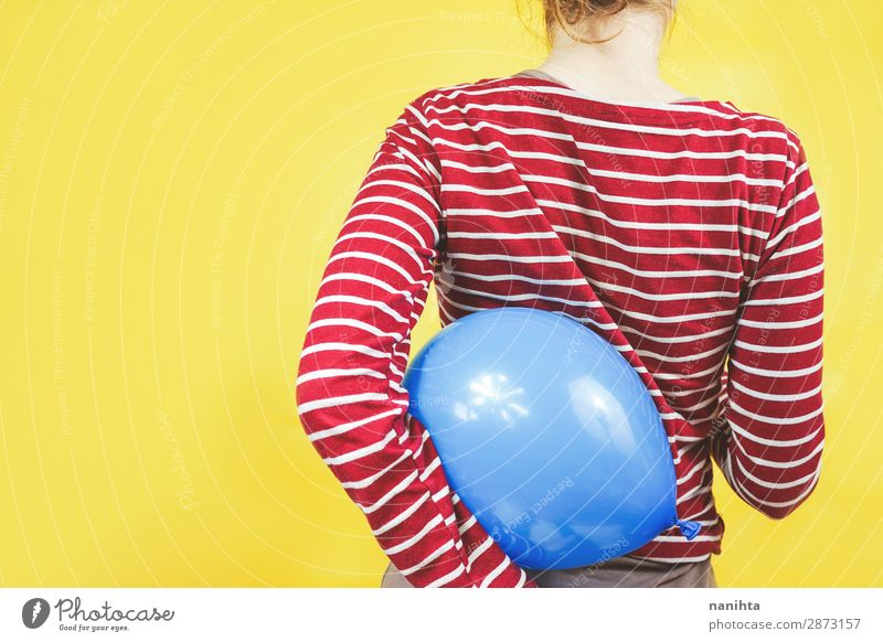 Back view of a girl holding a balloon Child Human being Youth (Young adults) Young woman Blue Colour Red Girl Yellow Feminine Feasts & Celebrations Style Art