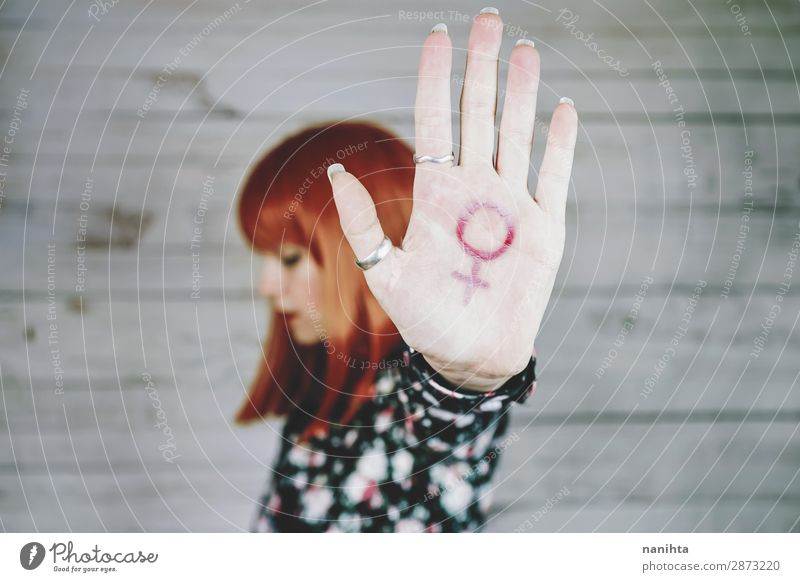 Young feminist with a female sign Lifestyle Style Design Human being Feminine Young woman Youth (Young adults) Woman Adults Arm Hand 1 18 - 30 years Red-haired