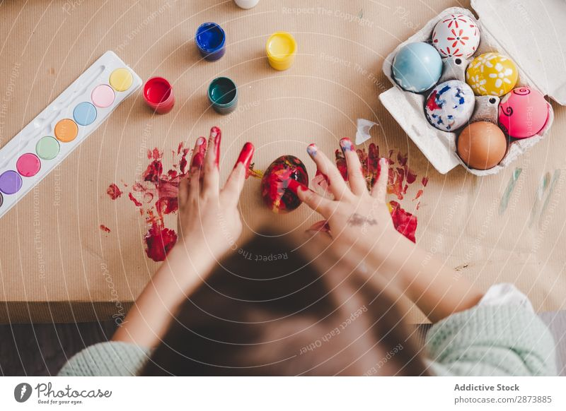Child with dirty hands near chicken eggs and colors at table Hand Easter Egg Dirty Painting (action, artwork) Palm of the hand Table Chicken Container Colour