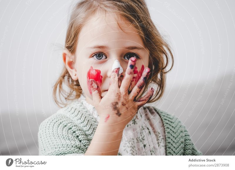 Girl with dirty hands coloring face Hand Dirty Colouring Face Painting (action, artwork) Funny Child Decoration Multicoloured Bright Woman Infancy Preparation