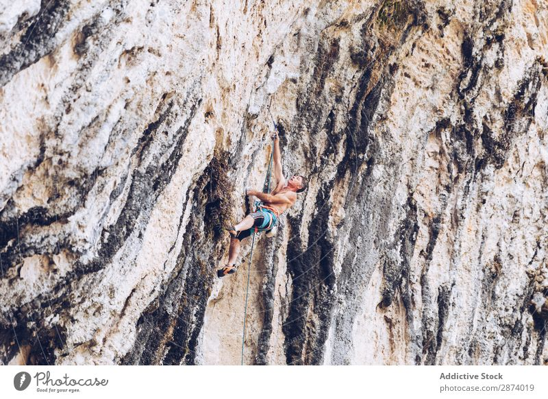 Anonymous man climbing rock Man Climbing Cliff Extreme Rock Sports challenge Action Success Power Height Hanging Rope Adventure Risk belay Mountain Sunbeam Day