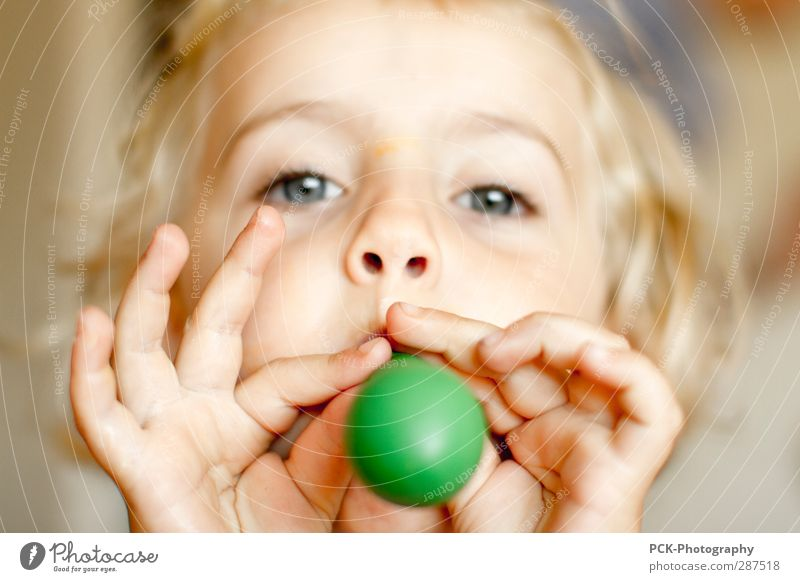 Human being Child Green Hand Girl Face Eyes Feminine Playing Hair and hairstyles Head Infancy Blonde Mouth Nose Balloon