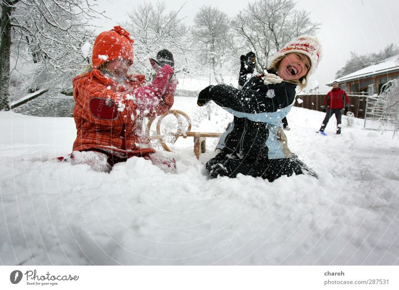 Human being Child Blue White Red Joy Girl Winter Black Mountain Snow Life Feminine Emotions Laughter Playing