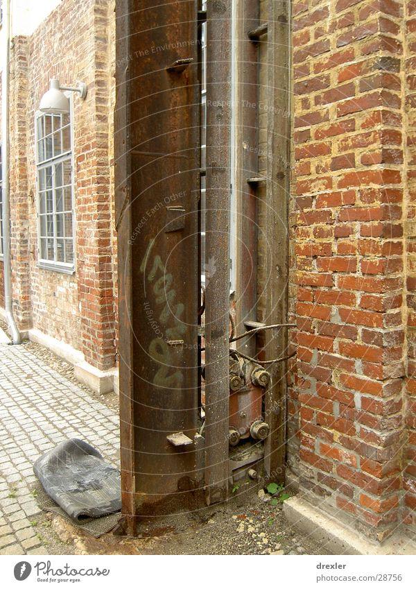 steel wheel Wall (barrier) Steel Column Architecture Graffiti Interior courtyard