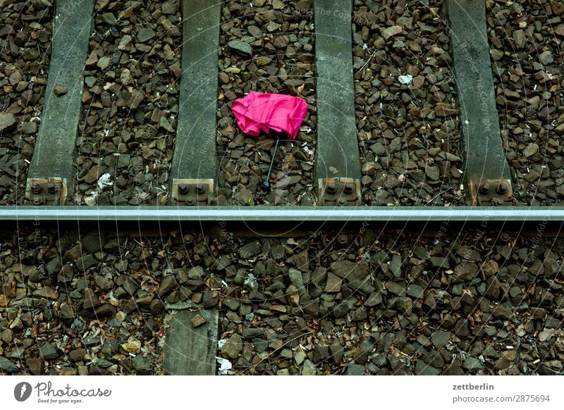Umbrella in track bed Umbrellas & Shades Lose Doomed Lie Discovery Discovery site Train station Berlin Railroad Deserted Public transit Commuter trains
