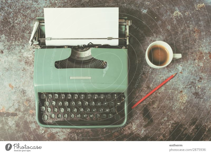 old typewriter next to a cup of coffee Drinking Hot drink Coffee Latte macchiato Espresso Lifestyle Desk Work and employment Office Paper Communicate Reading