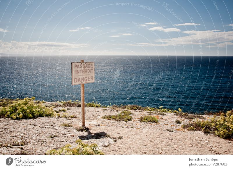 Sky Nature Blue Ocean Landscape Far-off places Environment Freedom Coast Horizon Signs and labeling Beautiful weather Dangerous Adventure To fall Vantage point