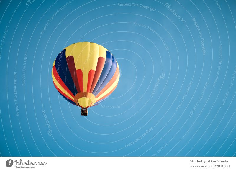 Colorful hot air balloon in the blue sky Joy Leisure and hobbies Vacation & Travel Adventure Freedom Sports Sky Transport Aircraft Hot Air Balloon Flying Dark