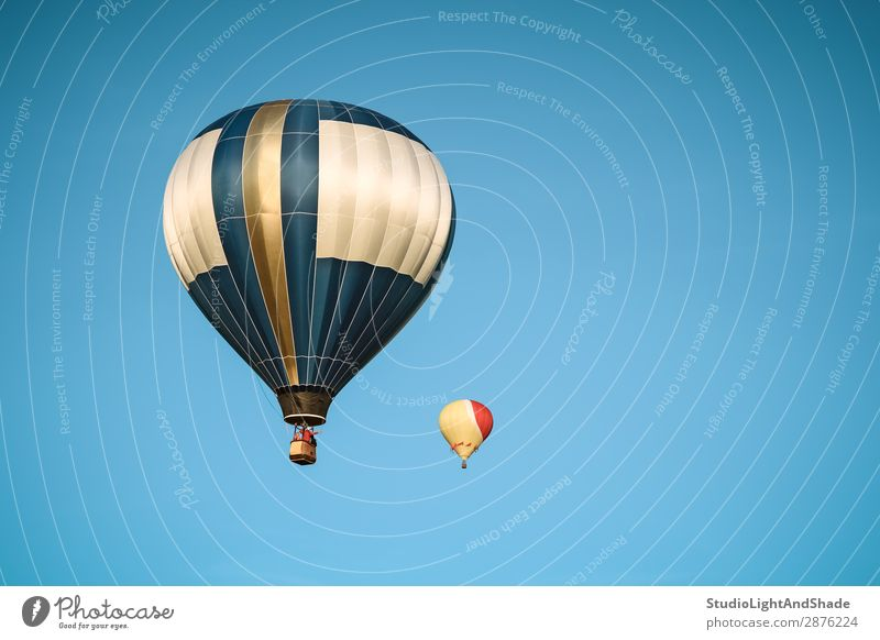 Two hot air balloons in the clear sky Joy Leisure and hobbies Vacation & Travel Adventure Freedom Sports Sky Transport Aircraft Hot Air Balloon Flying Dark