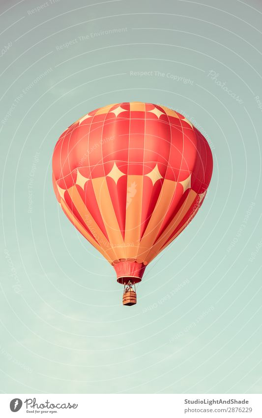 Orange hot air balloon in the sky Sky Vacation & Travel Old Colour Red Joy Sports Freedom Flying Leisure and hobbies Bright Transport Retro Action Adventure