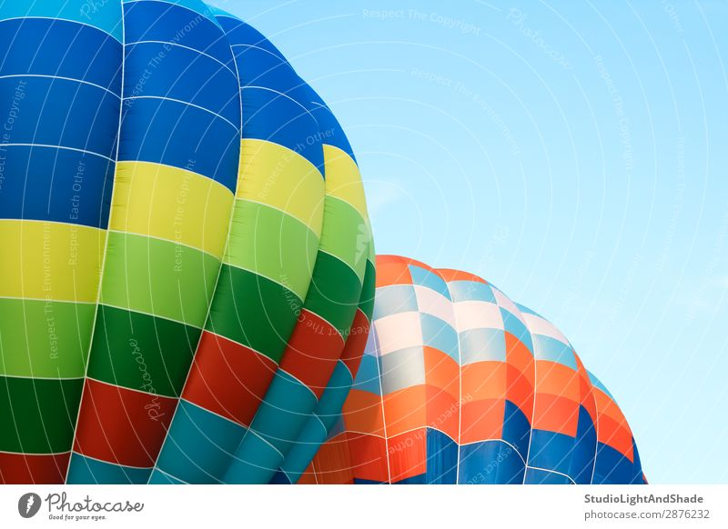 Closeup of multicolored hot air balloons Sky Vacation & Travel Blue Colour Green Joy Sports Freedom Flying Leisure and hobbies Bright Transport Action Adventure