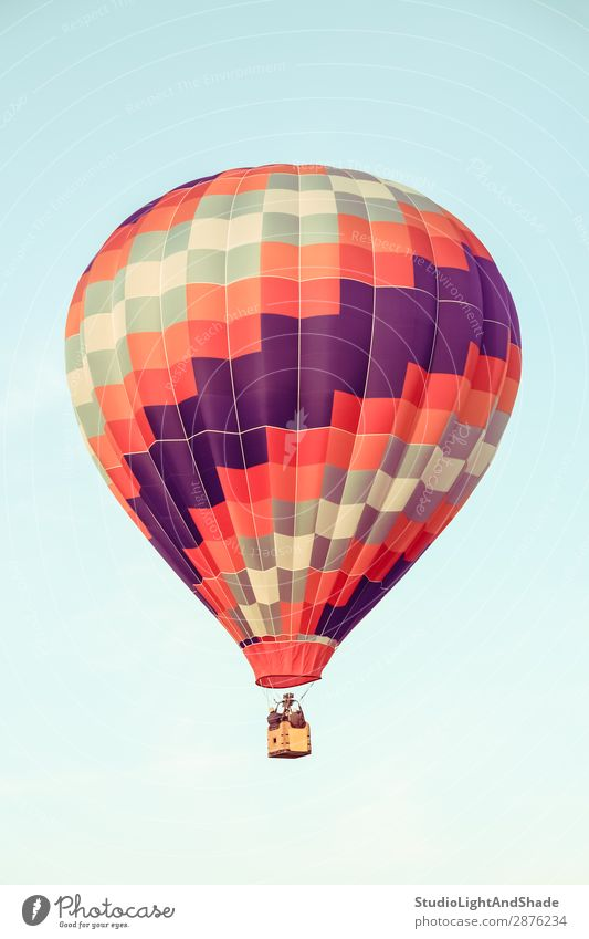 Red and purple hot air balloon Sky Vacation & Travel Old Blue Colour Joy Sports Freedom Flying Leisure and hobbies Bright Transport Retro Action Adventure