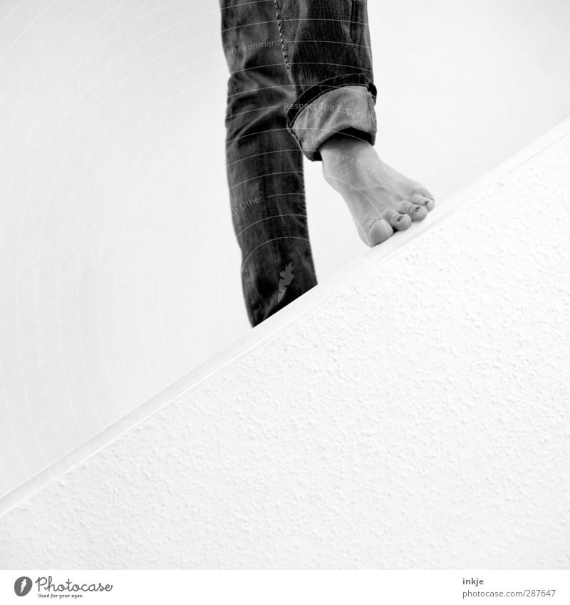 Step in between. It's got a hand and a foot. Feet 1 Human being Wall (barrier) Wall (building) Stairs Jeans Going Stand Simple Beginning Perspective