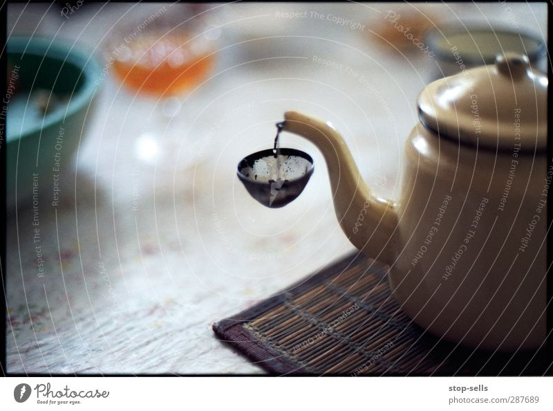 collecting device Food To have a coffee Slow food Beverage Hot drink Tea Warm-heartedness Purity Whimsical Teapot Tea strainer Catch Filter Kitchen Table