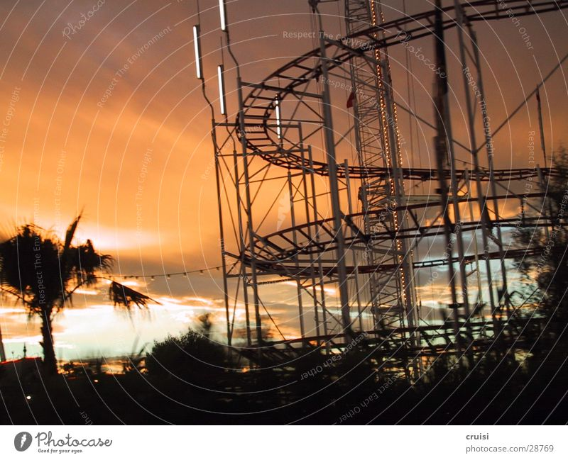 sculpture Vacation & Travel Railroad tracks Carousel St.Tropez Cannes Nice Sunset Electrical equipment Technology Orange Evening Cote d'Azur Sky